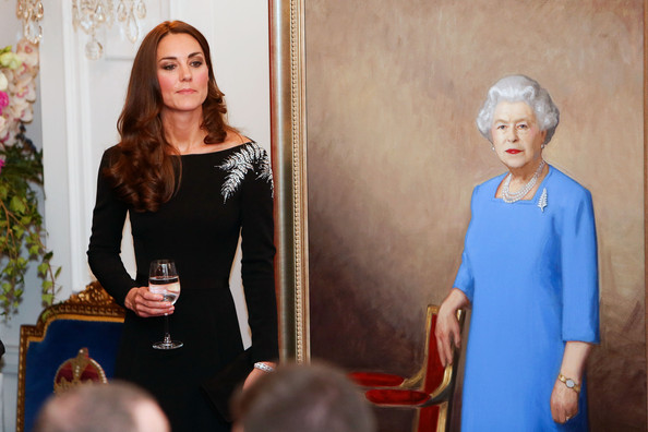 Catherine, Duchess of Cambridge stands next to a painting of Queen Elizabeth II unveiled during a state reception at Government House on April 10, 2014 in Wellington, New Zealand. The Duke and Duchess of Cambridge are on a three-week tour of Australia and New Zealand, the first official trip overseas with their son, Prince George of Cambridge.