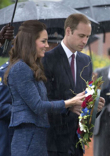 Prince William, Duke of Cambridge and Catherine, Duchess of Cambridge lay a wreath at the Remembrance Wall during a visit to the Royal New Zealand Police College on April 16, 2014 in Wellington, New Zealand. The Duke and Duchess of Cambridge are on a three-week tour of Australia and New Zealand, the first official trip overseas with their son, Prince George of Cambridge.