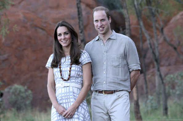 Catherine, Duchess of Cambridge and Prince William, Duke of Cambridge pose for a photo on the Kuniya walk at Uluru on April 22, 2014 in Ayers Rock, Australia. The Duke and Duchess of Cambridge are on a three-week tour of Australia and New Zealand, the first official trip overseas with their son, Prince George of Cambridge.