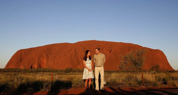Catherine, Duchess of Cambridge and Prince William, Duke of Cambridge pose in front of Uluru, also known as Ayers Rock, on April 22, 2014 in Ayers Rock, Australia. The Duke and Duchess of Cambridge are on a three-week tour of Australia and New Zealand, the first official trip overseas with their son, Prince George of Cambridge.