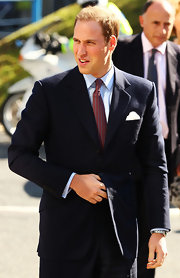Prince William looked handsome with his sun-kissed hair and navy suit for his visit to the Royal Marsden Hospital.
