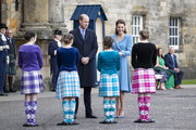 Prince William, Duke of Cambridge and Catherine, Duchess of Cambridge meet Highland dancers during a Beating of the Retreat at the Palace of Holyroodhouse on May 27, 2021 in Edinburgh, Scotland.