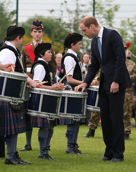 Prince William, Duke of Cambridge talks to children with drums during a visit to Strathearn Community Campus on May 29, 2014 in Crieff, Scotland. The Duke and Duchess of Cambridge will spend the day in Scotland where they will tour a distillery and visit a village fete.