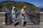 Prince Charles, Prince of Wales and Camilla, Duchess of Cornwall smile after a ribbon cutting ceremony at the new Tintagel bridge during their visit to Tintagel Castle in Cornwall, south west England on July 20, 2020 in Tintagel, England.