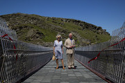 Prince Charles, Prince of Wales and Camilla, Duchess of Cornwall pose after a ribbon cutting ceremony at the new Tintagel bridge during their visit to Tintagel Castle in Cornwall, south west England on July 20, 2020 in Tintagel, England.