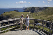 Prince Charles, Prince of Wales and Camilla, Duchess of Cornwall pose at the lookout point on Tintagel Castle island during their visit to Tintagel Castle in Cornwall, south west England on July 20, 2020 in Tintagel, England.