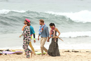 Prince Harry, Duke of Sussex and Meghan, Duchess of Sussex walk along Bondi Beach with Grant Trebilco and Sam Schumacher, founder and co-founder of OneWave, a local surfing community group raising awareness for mental health and wellbeing at Bondi Beach on October 19, 2018 in Sydney, Australia. The Duke and Duchess of Sussex are on their official 16-day Autumn tour visiting cities in Australia, Fiji, Tonga and New Zealand.
