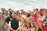 Prince Harry, Duke of Sussex and Meghan, Duchess of Sussex pose with Grant Trebilco and Sam Schumacher, founder and co-founder of OneWave, a local surfing community group raising awareness for mental health and wellbeing and their members on Bondi Beach on October 19, 2018 in Sydney, Australia. The Duke and Duchess of Sussex are on their official 16-day Autumn tour visiting cities in Australia, Fiji, Tonga and New Zealand.