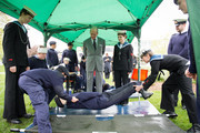 Britain's Prince Philip, Duke of Edinburgh observes first aid training during a visit to the Windsor Sea Cadet Unit on April 7, 2014 in in Windsor, England. T.S Windsor Castle is the oldest unit in the Sea Cadet Corps, established in 1899 as a way to provide a small training vessel on the river at Windsor.