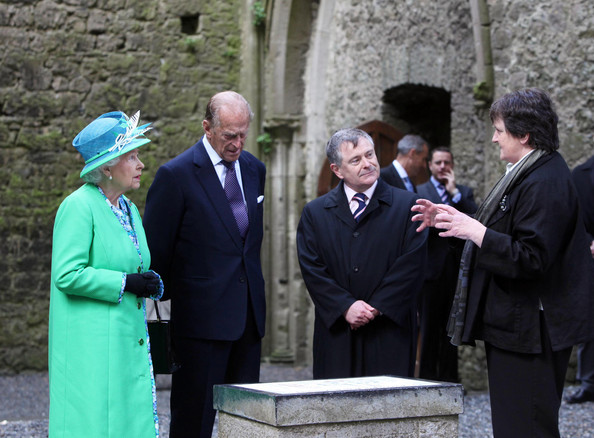 Duke of Edinburgh Queen Elizabeth II and Prince Philip, Duke of Edinburgh visit the nave of the Cathedral at the Rock of Cashel accompanied by Minister for Public Expenditure and Reform Brendan Howlin TD as they speak to Head Curator Aighleann O'Shaughnessy (R) on May 20, 2011 in Cashel, Ireland. The Duke and Queen are on a historic four-day tour of the Republic of Ireland amid tight security, the first visit to Ireland by a British monarch since 1911. Republican dissident groups have made it clear they are intent on disrupting proceedings.
