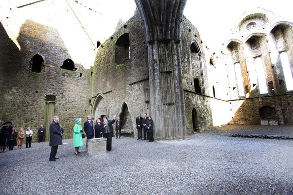 Duke of Edinburgh Queen Elizabeth II and Prince Philip, Duke of Edinburgh visit the nave of the Cathedral at the Rock of Cashel accompanied by Minister for Public Expenditure and Reform Brendan Howlin TD (2nd, R) and Dr Eugene Keane (L) with Head Curator Aighleann O'Shaughnessy (R) on May 20, 2011 in Cashel, Ireland. The Duke and Queen are on a historic four-day tour of the Republic of Ireland amid tight security, the first visit to Ireland by a British monarch since 1911. Republican dissident groups have made it clear they are intent on disrupting proceedings.