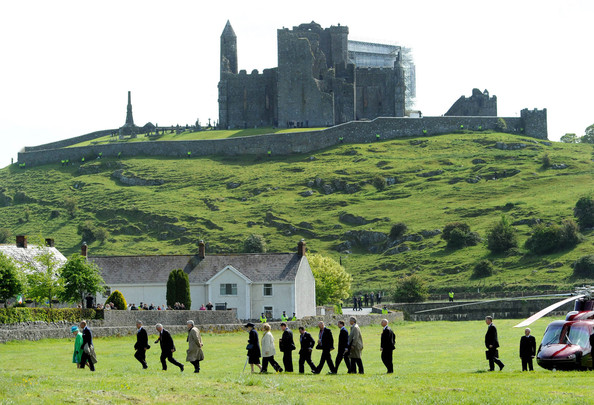 Duke of Edinburgh Queen Elizabeth II and Prince Philip, Duke of Edinburgh walk in front of the Rock of Cashel after arriving by helicopter on May 20, 2011 in Cashel, Ireland. The Duke and Queen are on an historic four-day tour of the Republic of Ireland, the first visit to Ireland by a British monarch since 1911.