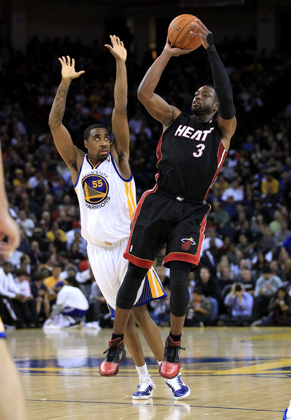 Miami Heat v Golden State Warriors [photograph,basketball,player,basketball moves,sports,basketball court,basketball player,team sport,ball game,tournament,dwayne wade 3,user,user,note,ball,terms,oakland,miami heat,golden state warriors]