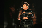 """Singer Jill Scott performs onstage at A+E Networks """"Shining A Light"""" concert at The Shrine Auditorium on November 18, 2015 in Los Angeles, California."""