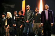 """(L-R) Recording artists Zac Brown, Tori Kelly, Jamie Foxx, Jill Scott, Eric Church, Miguel and Smokey Robinson perform onstage at A+E Networks """"Shining A Light"""" concert at The Shrine Auditorium on November 18, 2015 in Los Angeles, California."""