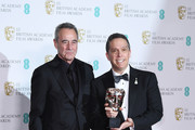 Jim Morris (L) and Lee Unkrich, winners of the Best Animated Film award for 'Coco' pose in the press room during the EE British Academy Film Awards (BAFTA) held at Royal Albert Hall on February 18, 2018 in London, England.