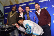 Music artists Biz Markie (L) and DJ Cool V pose for a picture with guests at EW & CNN The Eighties Trivia Event at The Django at the Roxy Hotel on March 29, 2016 in New York City.