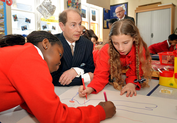 Prince Edward, Earl of Wessex talks to pupils in a classroom during an official visit on the Earl's 50th Birthday to Robert Browning Primary School in Walworth to see the work of youth charity Kidscape, recipients of grants from the Wessex Youth Trust, on March 10, 2014 in London, United Kingdom.