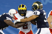 East's De'Veon Smith #2 of Michigan fights his way through the arm tackle West's Kevin Davis #33 of Colorado State during the second quarter of the East-West Shrine Game at Tropicana Field on January 21, 2017, in St. Petersburg, Florida.