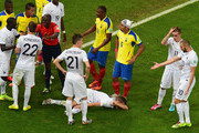 Lucas Digne of France lies on the field after being fouled by Antonio Valencia of Ecuador during the 2014 FIFA World Cup Brazil Group E match between Ecuador and France at Maracana on June 25, 2014 in Rio de Janeiro, Brazil.  Referee Noumandiez  Doue sent Valencia off with a red card for the foul.