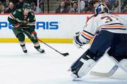 Zach Parise #11 of the Minnesota Wild controls the puck as Cam Talbot #33 of the Edmonton Oilers defends the net during the game on April 2, 2018 at Xcel Energy Center in St Paul, Minnesota. The Wild defeated the Oilers 3-0.