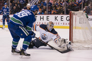 Sam Gagner #89 of the Vancouver Canucks shoots the puck over the glove of goalie Cam Talbot #33 of the Edmonton Oilers for a goal in NHL action on March, 29, 2018 at Rogers Arena in Vancouver, British Columbia, Canada.
