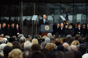 U.S. President Barack Obama speaks during the Edward M. Kennedy Institute Dedication Ceremony as (L to R) First Lady Michelle Obama, Boston Mayor Marty Walsh, U.S. Senator Edward Markey, U.S. Vice President Joe Biden, Cardinal Sean O'Malley, Jean Kennedy Smith, and Patrick Kennedy listen March 30, 2015 in Boston, Massachusetts. The Edward Kennedy Institute is a testament to one of the longest serving U.S. Senators.