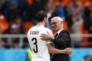 Diego Godin of Uruguay speaks with Hector Cuper, Head coach of Egypt following the 2018 FIFA World Cup Russia group A match between Egypt and Uruguay at Ekaterinburg Arena on June 15, 2018 in Yekaterinburg, Russia.