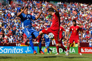 David Villa of Spain duels for the ball with Alexander Mendoza of El Salvador during an international friendly match between El Salvador and Spain at FedExField on June 7, 2014 in Landover, Maryland.