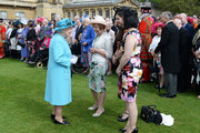 Queen Elizabeth II greets guests attending a garden party at Buckingham Palace on May 24, 2016 in London, England.
