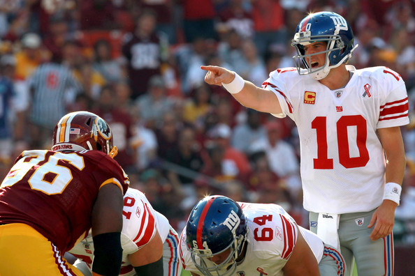 Eli Manning Quarterback Eli Manning #10 of the New York Giants calls out from under center against the Washington Redskins in the second quarter at FedExField on September 11, 2011 in Landover, Maryland.