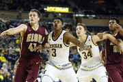 Kameron Chatman #3 of the Michigan Wolverines battles for position with Tyler Seibring #41 of the Elon Phoenix as Mark Donnal #34 of the Michigan Wolverines battles for position against Brian Dawkins #00 of the Elon Phoenix during the first half at Crisler Arena on November 16, 2015 in Ann Arbor, Michigan. Michigan won 88-68.