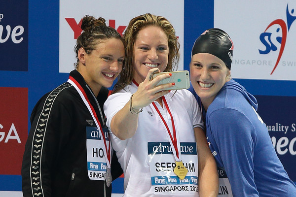 FINA World Cup - Singapore [medal,championship,gold medal,silver medal,competition event,technology,competition,recreation,sports,electronic device,missy franklin,katinka hosszu,medallist,l-r,selfie,podium,singapore,hungary,united states of america,fina world cup]