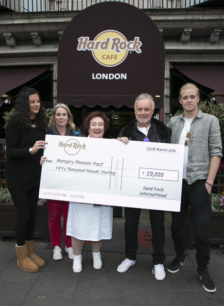 Queen's Roger Taylor Accepts a Cheque For The Mercury Phoenix Trust