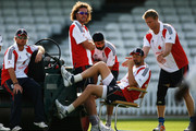 (L-R) Ian Bell, Ryan Sidebottom, and Monty Panesar look on as Andrew Flintoff (R) plays a joke on Steve Harmison during the England nets session at The Brit Oval on August 19, 2009 in London, England.