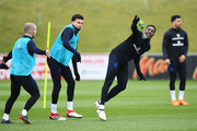 Danny Welbeck, Deli Alli and Jack Wilshire take part in a drill during an England training session on the eve of their international friendly against the Netherlands at St Georges Park on March 22, 2018 in Burton-upon-Trent, England.
