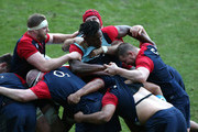 Maro Itoje is held by George Kruis, James Haskell and Dylan Hartley (R) in the mauling practice during the England training session held at Pennyhill Park on February 10, 2016 in Bagshot, England.