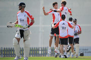 Steven Finn and Stuart Broad of England celebrate the wicket Kevin Pietersen during a nets session at The ICC Global Academy on January 6, 2012 in Dubai, United Arab Emirates.