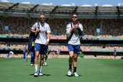Stuart Broad and Kevin Pietersen walk to the nets during an England nets session at The Gabba on November 20, 2013 in Brisbane, Australia.