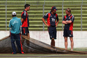 England captain Alastair Cook (c) Kevin Pietersen (l) and Paul Collingwood take a look at the pitch during England nets at Shere-e-Bangla National Stadium on March 19, 2010 in Dhaka, Bangladesh.