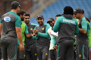 Pakistan captain Sarfraz Ahmed laughs alongside his teammates during a nets session at Headingley on May 31, 2018 in Leeds, England.