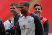 Steven Gerrard shares a laugh with Glen Johnson and Scott Parker during the England Training and Press Conference at Wembley Stadium on February 28, 2012 in London, England.