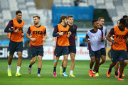 (L-R) Chris Smalling, Luke Shaw, Adam Lallana, Ross Barkley, Raheem Sterling and Jordan Henderson job during an England training session ahead of the 2014 FIFA World Cup Brazil Group D match against Costa Rica at Estadio Mineirao on June 23, 2014 in Belo Horizonte, Brazil.