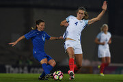Daniela Stracchi of Italy is challenged by Jill Scott of England during the Women's International friendly match between England and Italy at Vale Park on April 7, 2017 in Burslem, England.