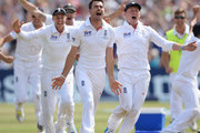 James Anderson (C) of England celebrates the final wicket of Brad Haddin of Australia and victory with Joe Root (L) and Jonny Bairstow during day five of the 1st Investec Ashes Test match between England and Australia at Trent Bridge Cricket Ground on July 14, 2013 in Nottingham, England.