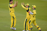 Clint Mckay of Australia celebrates with Michael Clarke and wicketkeeper Matthew Wade after dismissing Ravi Bopara of England during the 1st Natwest One Day International Series between England and Australia at Lord's Cricket Ground on June 29, 2012 in London, England.
