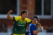 Pat Cummins of Australia celebrates taking the wicket of Chris Woakes of England during the 2nd Royal London One-Day International match between England and Australia at Lord's Cricket Ground on September 5, 2015 in London, United Kingdom.