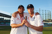 Andrew Flintoff (R) of England poses with Steve Harmison and the Ashes urn after day four of the npower 5th Ashes Test Match between England and Australia at The Brit Oval on August 23, 2009 in London, England.
