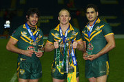 Johnathan Thurston (Man of the Match), Darren Lockyer (captain) and Greg Inglis (Man of the Series) hold their trophies after victory over England in the Four Nations Grand Final at Elland Road on November 14, 2009 in Leeds, England.
