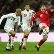 Wayne Rooney Hossam Ghaly Photos
